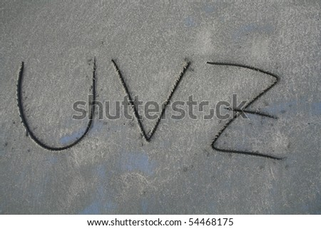 Alphabet letters written in the sand - Complete alphabet set in my gallery - stock photo