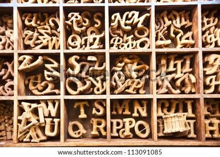 Alphabet made from wood in the square box - stock photo