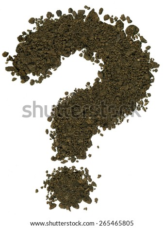 Alphabet made of brown soil on white background. High sharp and detail. Question mark - stock photo
