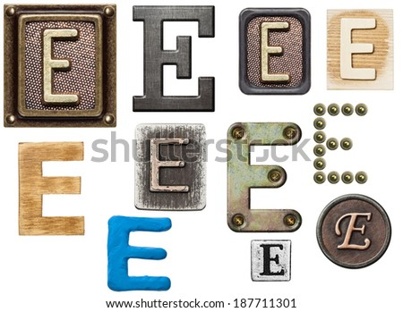 Alphabet made of wood, metal, plasticine. Letter E - stock photo