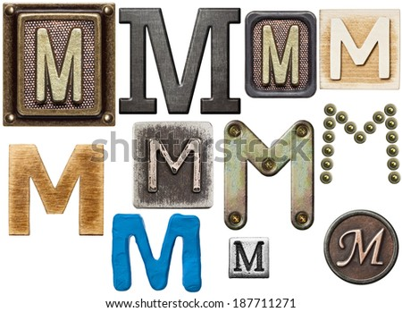 Alphabet made of wood, metal, plasticine. Letter M - stock photo