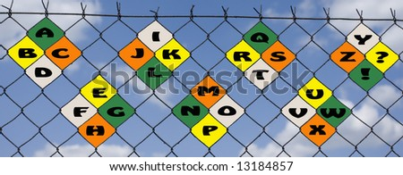 alphabet on a wire fence - stock photo