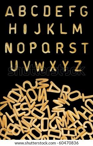 Alphabet soup pasta font. Kids food background. - stock photo