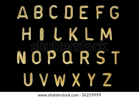 Alphabet soup pasta font. Typographic characters made from kids food. - stock photo