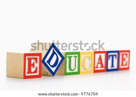 Alphabet toy building blocks spelling the word educate. - stock photo