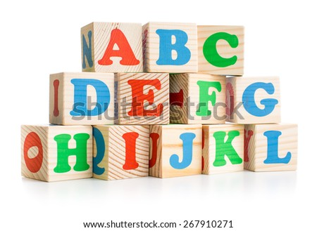 alphabet wood bricks tower or wall isolated on white - stock photo
