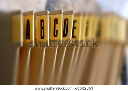 Alphabetical filing tray index office documents organizer. Selective focus.