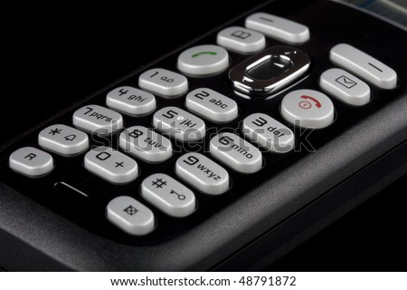 alphanumeric keys on a telephone keyboard. studio closeup - stock photo