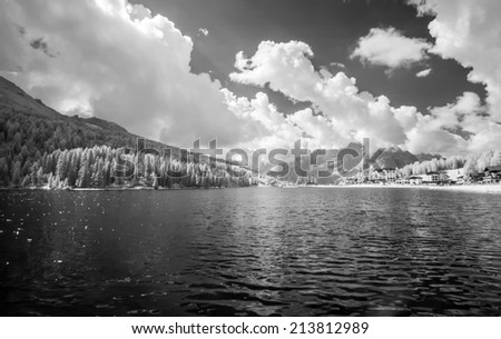 Alpin lake in infrared view. - stock photo