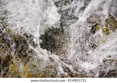 alpin stream with water cascade in detail - stock photo