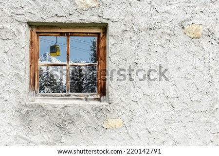 alpine cable car in the window - stock photo