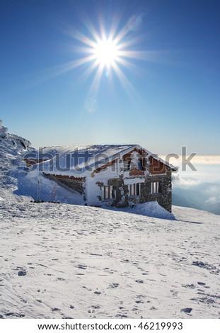 Alpine chalet in ski resort Jasna (Kamenna chata) Winter landscape - Low Tatras - Slovakia - stock photo