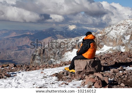 Alpine climber acclimating at camp two of Aconcagua - stock photo