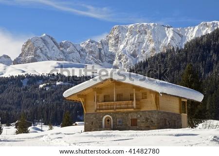 Alpine cottage - stock photo