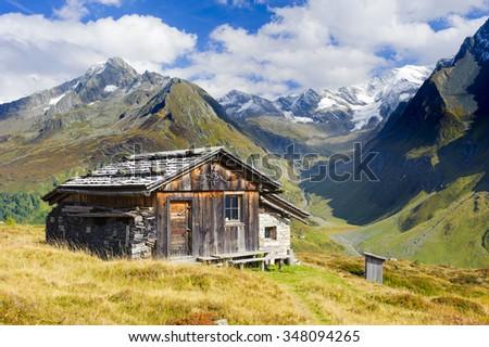 alpine farm hut in south tyrol alps mountains - stock photo