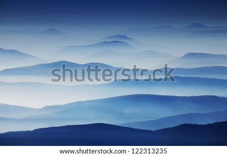 Alpine foggy landscape in the Transylvanian Alps, Romania - stock photo
