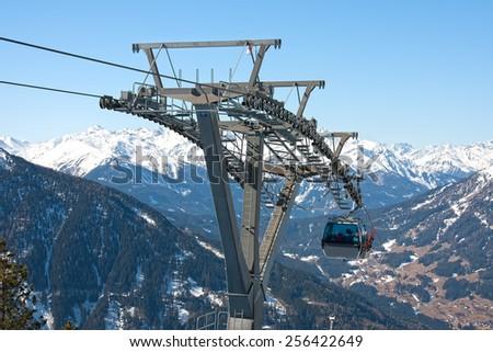 Alpine gondola ski lift  - stock photo