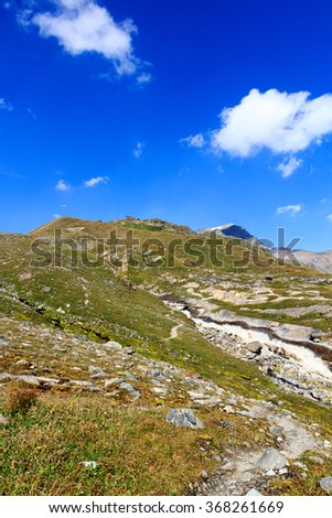 Alpine hut Badener Hutte, mountain Kristallwand and rapid stream in Hohe Tauern Alps, Austria - stock photo