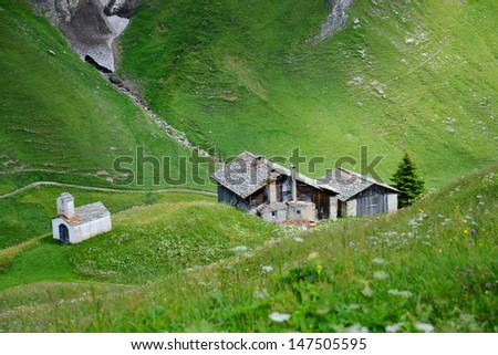 Alpine hut in Switzerland - stock photo