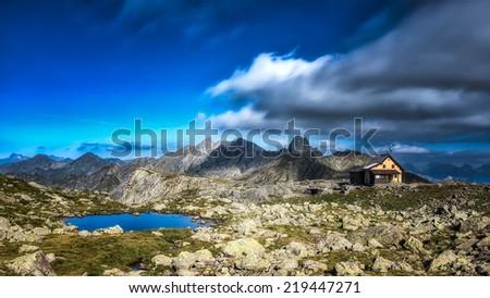 Alpine hut in the italian alps - stock photo
