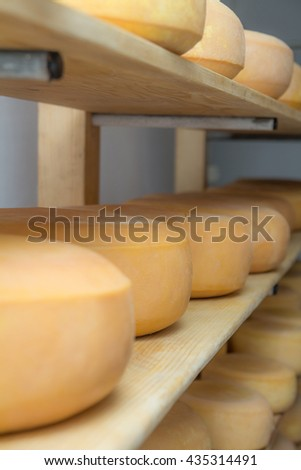 Alpine hut that produces and sells homemade cheeses.  - stock photo