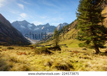 Alpine huts in autumn mountains - stock photo