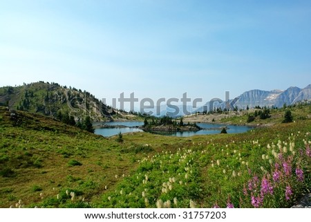 Alpine lake and mountains in sunshine meadow, banff national park, alberta, canada - stock photo