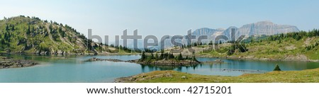 Alpine lake and mountains in sunshine meadows in banff national park, alberta, canada - stock photo