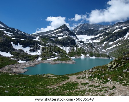 Alpine lake as a permanent element in the high mountains