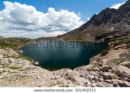 Alpine lake in the tundra of the Colorado Rocky Mountains - stock photo