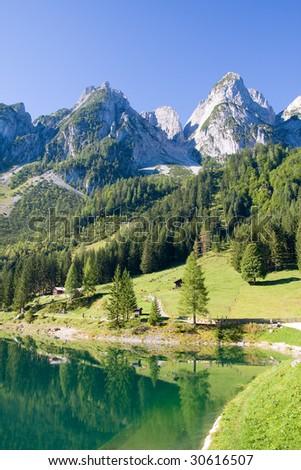 alpine lake scenery in the summer - stock photo