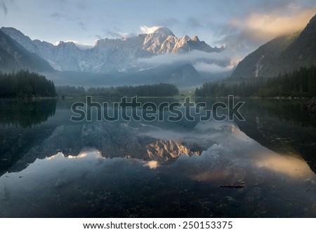 Alpine lake,Sunrise over the alpine lake Laghi di Fusine - stock photo