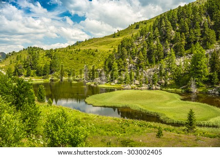 Alpine landscape, Lake Windebensee in Nockalmstrasse, Carinthia, Austria - stock photo