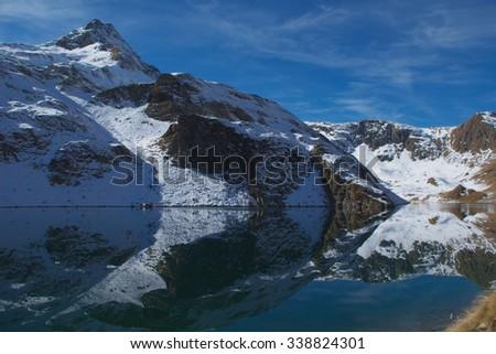 Alpine landscape reflected in a mountain lake - Lake Aviasco, Bergamo Alps, Italy - stock photo