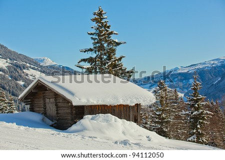 Alpine landscape. Snow-covered house, mountains. Tyrol, Austria - stock photo