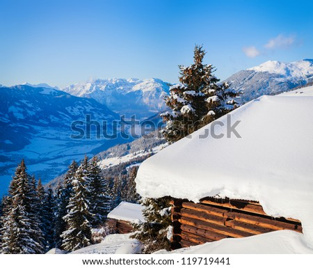 Alpine landscape. Snow-covered house, mountains. Zell am Ziller, Tirol, Austria - stock photo