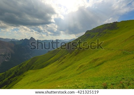 Alpine landscape with rain starting to fall - stock photo