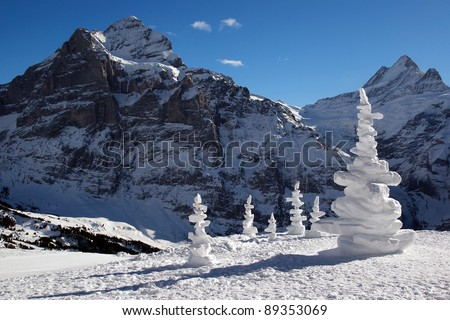 Alpine landscape with snow sculptures in winter sunny day. Switzerland