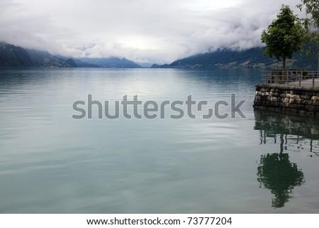 Alpine mist on the lake Brienz in Switzerland - stock photo
