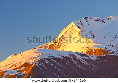 Alpine peak at sunset - stock photo