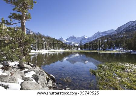 Alpine reflections in Heart Lake, Sierra Nevada mountains in eastern California - stock photo