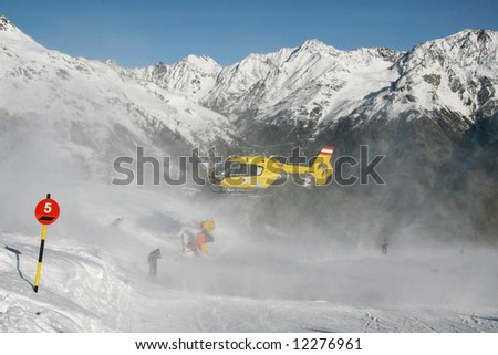 Alpine rescue helicopter flies up - stock photo