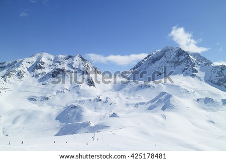 Alpine resort of Les Arcs with ski slopes on snowy French Alps mountains - stock photo