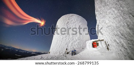 Alpine ridge Montenegro - stands on the slopes of the Ukrainian Carpathians ancient observatory built against a background of deep snow peaks and bitter cold strong wind waiting climber - extremals - stock photo
