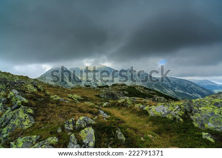 Alpine scenery in the Alps, with storm clouds