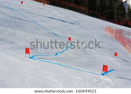 Alpine ski racing course with sets of gates - stock photo