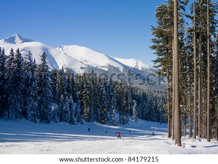Alpine ski slope at winter resort Bansko, Bulgaria - stock photo
