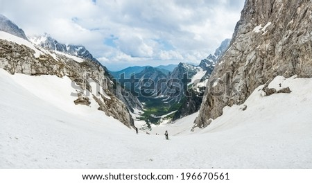 Alpine valley covered win spring snow, Tamar, Slovenia - stock photo