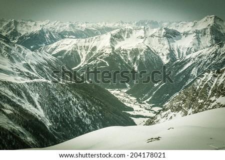 Alpine valley surrounded with snow covered mountain, Mallnitz, Austria - stock photo