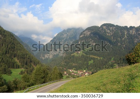 Alpine village Hinterbichl (muncipal Pragraten am Grossvenediger) with mountains, Austria - stock photo